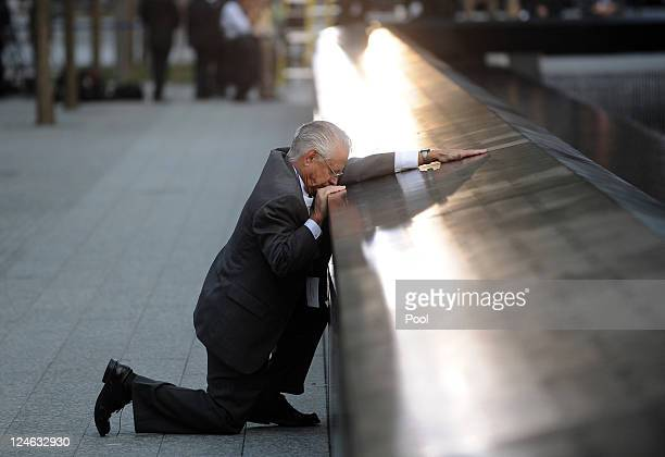 Robert Peraza who lost his son Robert David Peraza pauses at his son's name at the North Pool of the 9/11 Memorial during tenth anniversary...