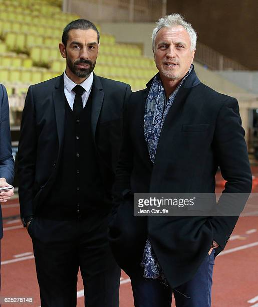 Robert Pires and David Ginola look on following the UEFA Champions League match between AS Monaco FC and Tottenham Hotspur FC at Stade Louis II on...