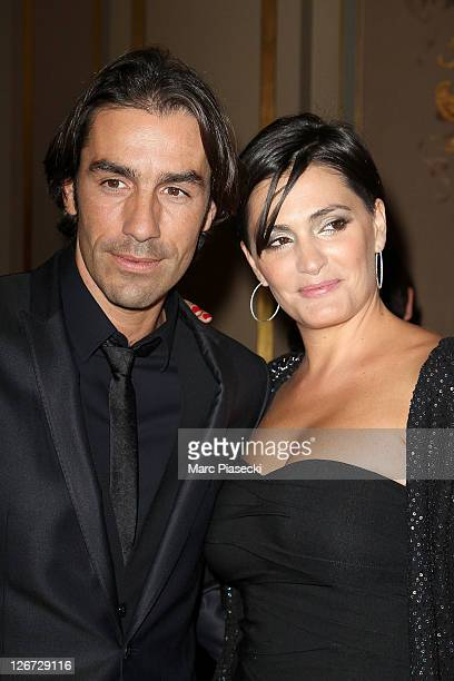 Robert Pires and his wife Nathalie attend the 'ParCoeur Gala' at Mairie de Paris on September 26, 2011 in Paris, France.