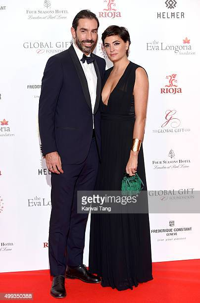 Robert Pires and Jessica Lemarie attend The Global Gift Gala at Four Seasons Hotel on November 30 2015 in London England