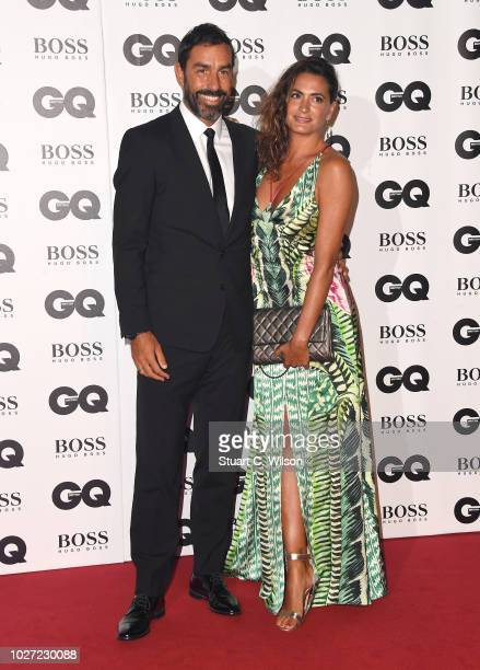 Robert Pires and Jessica Lemarie attend the GQ Men of the Year awards at the Tate Modern on September 5 2018 in London England