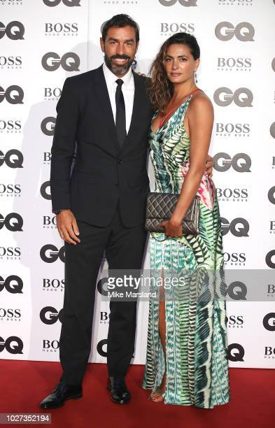 Robert Pires and Jessica Lemarie attend the GQ Men of the Year awards at Tate Modern on September 5 2018 in London England