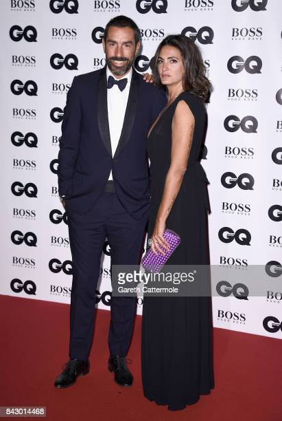 Robert Pires and Jessica Lemarie attend the GQ Men Of The Year Awards at the Tate Modern on September 5 2017 in London England