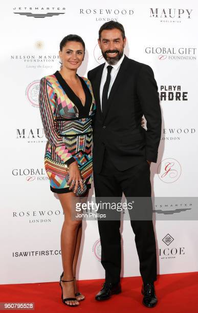 Robert Pires and Jessica Lemarie attend The Nelson Mandela Global Gift Gala at Rosewood London on April 24 2018 in London England