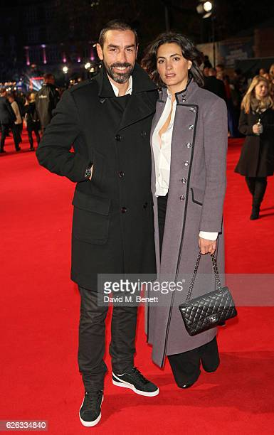 "Robert Pires and Jessica Lemarie attend the World Premiere of ""I Am Bolt"" at Odeon Leicester Square on November 28, 2016 in London, England."