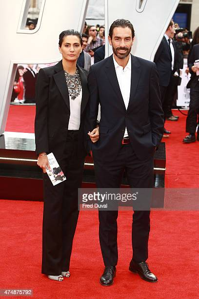 Robert Pires and Jessica Lemarie Pires attends the UK Premiere of Spy at Odeon Leicester Square on May 27 2015 in London England