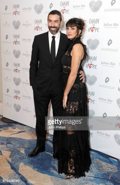 Robert Pires and Jessica LemariePires arriving at the Chain Of Hope Gala Ball held at Grosvenor House on November 17 2017 in London England