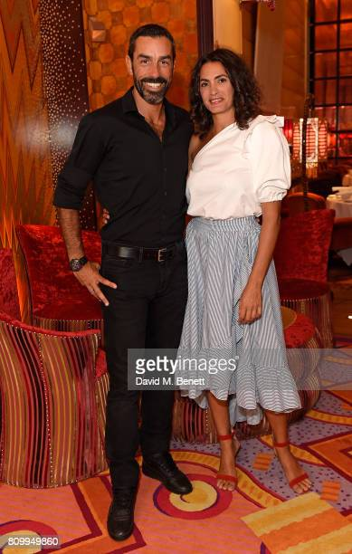 Robert Pires and Jessica LemariePires attend a private dinner to celebrate the Havaianas Art Auction in aid of Women for Women International curated...
