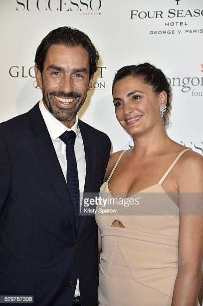 Robert Pires and Jessica LemariePires attend the Global Gift Gala Photocall at the Hotel Georges V on May 09 2016 in Paris France