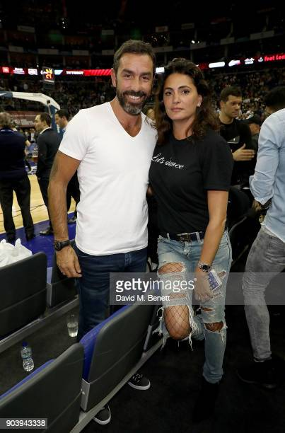 Robert Pires and Jessica LemariePires attend the Philadelphia 76ers and Boston Celtics London game at The O2 Arena on January 11 2018 in London...