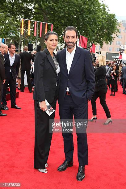Robert Pires and Jessica LemariePires attend the UK Premiere of Spy at Odeon Leicester Square on May 27 2015 in London England
