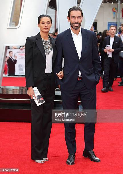"Robert Pires and Jessica Lemarie-Pires attend the UK Premiere of ""Spy"" at Odeon Leicester Square on May 27, 2015 in London, England."