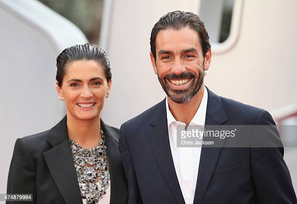 Robert Pires and Jessica LemariePires attends the UK Premiere of Spy at Odeon Leicester Square on May 27 2015 in London England