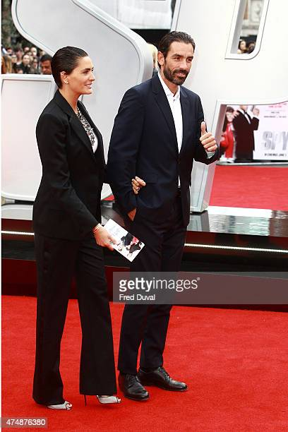 Robert Pires and Jessica Pires attend the UK Premiere of Spy at Odeon Leicester Square on May 27 2015 in London England