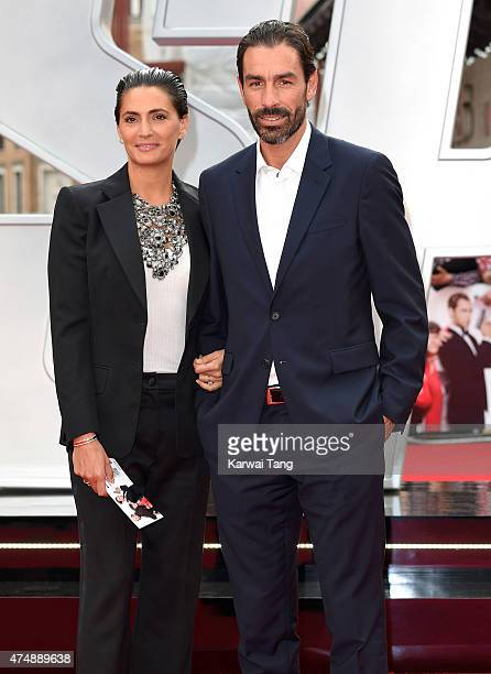 "Robert Pires and wife Jessica Lemarie attend the UK Premiere of ""Spy"" at Odeon Leicester Square on May 27, 2015 in London, England."
