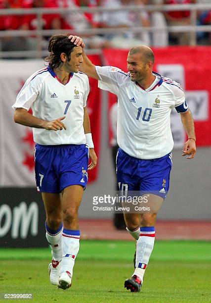 Robert Pires and Zinedine Zidane celebrate