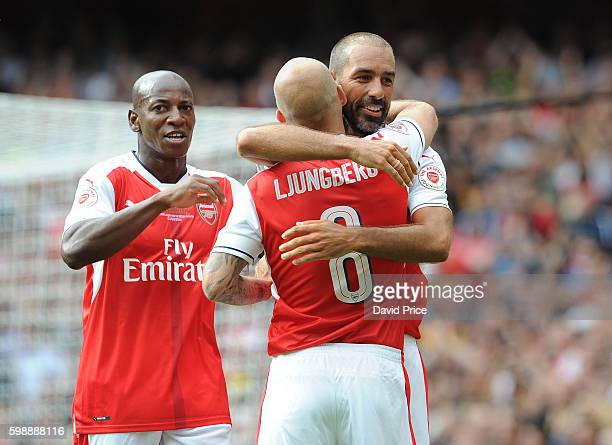 Robert Pires celebrates scoring Arsenal Legends 4th goal with Freddie Ljungberg and Luis Boa Morte during the Arsenal Foundation Charity match...