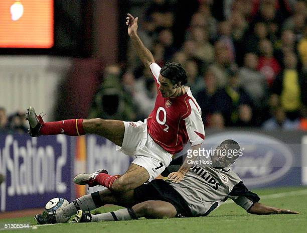 Robert Pires of Arsenal is tackled by Jefferson Farfan of PSV Eindhoven during the UEFA Champions League Group E match between Arsenal and PSV...