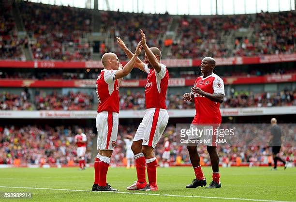 Robert Pires of Arsenal Legends celebrates after scoring with Freddie Ljungberg and Luis Boa Morte of Arsenal Legends during the Arsenal Foundation...