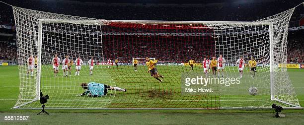 Robert Pires of Arsenal sends Hans Vonk of Ajax the wrong way to score from the penalty spot during the UEFA Champions League Group B match between...