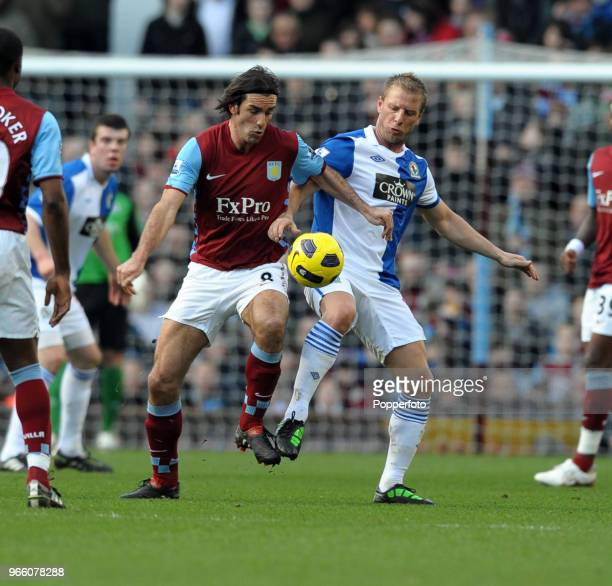 Robert Pires of Aston Villa battles with Vince Grella of Blackburn Rovers during the Barclays Premier League match between Aston Villa and Blackburn...