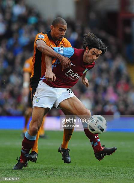 Robert Pires of Aston Villa is challenged by Karl Henry of Wolves during the Barclays Premier League match between Aston Villa and Wolverhampton...
