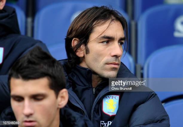 Robert Pires of Aston Villa watches fom the bench during the Barclays Premier League match between Blackburn Rovers and Aston Villa at Ewood Park on...