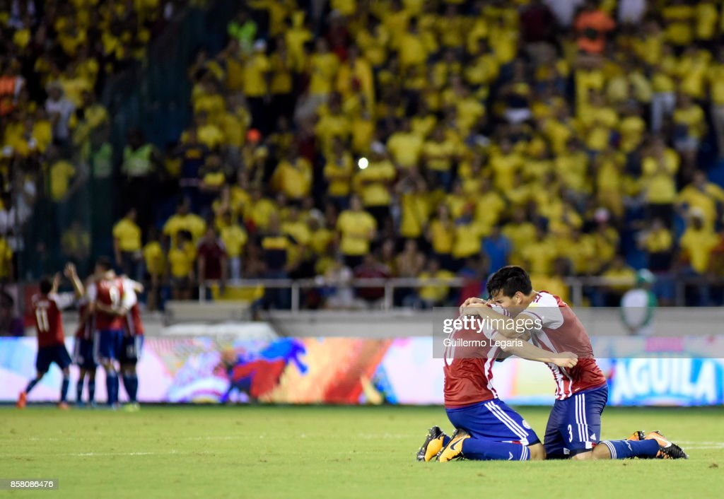 Robert Piris and Gustavo Gomez of Paraguay celebrate after winning a match between Colombia and Paraguay as part of FIFA 2018 World Cup Qualifiers at Metropolitano Roberto Melendez Stadium on October 05, 2017 in Barranquilla, Colombia.