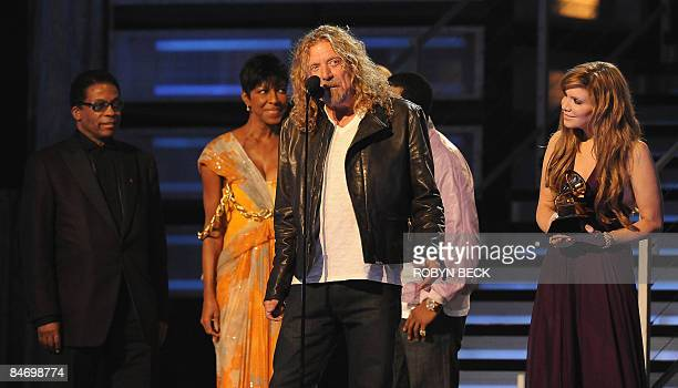 Robert Plant and Alison Krauss receive the Record of the Year award from Herbie Hancock and Natalie Cole during the 51st annual Grammy awards held at...