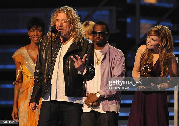 Robert Plant and Alison Krauss receive the Record of the Year award from Natalie Cole and Sean Diddy Combs during the 51st annual Grammy awards held...