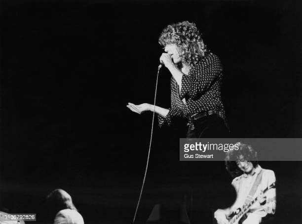 Robert Plant and Jimmy Page of Led Zeppelin perform on stage at Knebworth, August 1979.