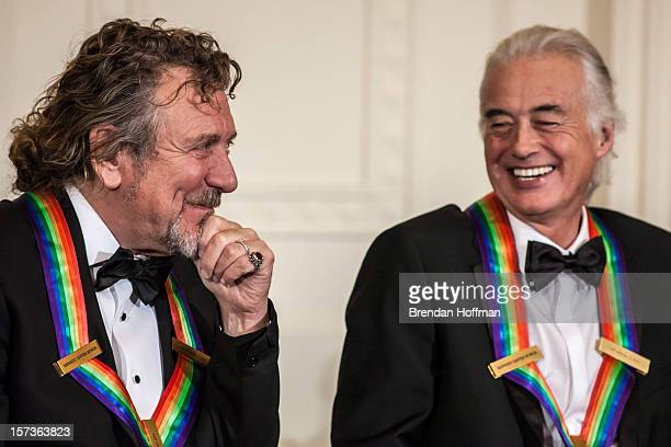 Robert Plant and Jimmy Page of the band Led Zeppelin attend the Kennedy Center Honors reception at the White House on December 2 2012 in Washington...