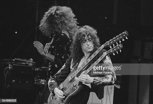 Robert Plant and Jimmy Page performing with British heavy rock group Led Zeppelin, at Earl's Court, London, May 1975. The band were initially booked...