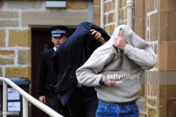 Robert Podesta leaves Dornoch Sheriff Court in Scotland with a friend after he fined 1000 for secretly filming the starstudded christening of...