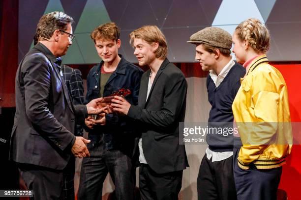 Robert Poelzer chief editor Bunte magazine with the actors and award winners of 'Das schweigende Klassenzimmer' Leonard Schleicher Tom Gramenz Jonas...