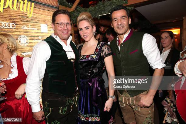 Robert Poelzer Editor in chief of Bunte and Danila Langguth and Erol Sander during the 28th Weisswurstparty at Hotel Stanglwirt on January 25 2019 in...