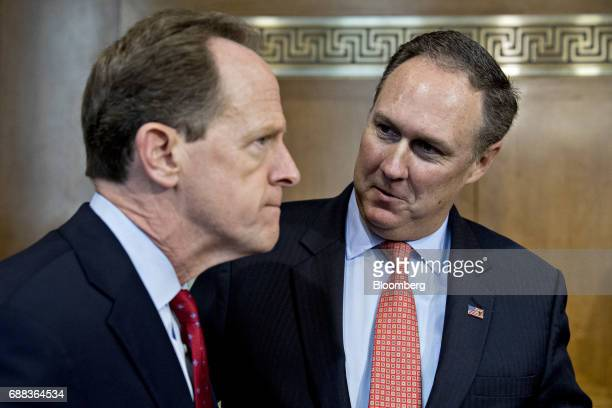Robert Powelson nominee to be a member of the Federal Energy Regulatory Commission for US President Donald Trump right talks to Senator Patrick...