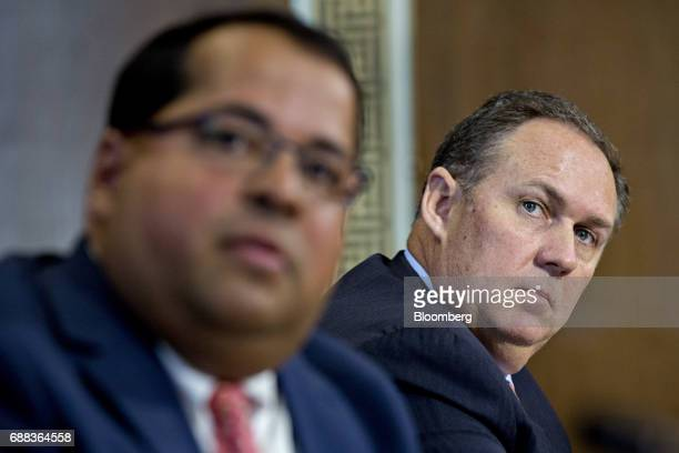 Robert Powelson nominee to be a member of the Federal Energy Regulatory Commission for US President Donald Trump right listens during a Senate Energy...