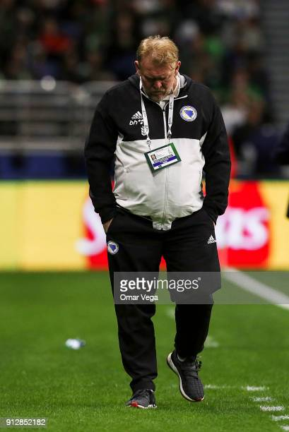 Robert Prosinecki coach of Bosnia walks on the sideline during the friendly match between Mexico and Bosnia and Herzegovina at Alamodome Stadium on...