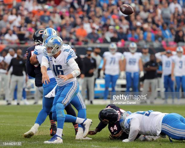 Robert Quinn of the Chicago Bears forces a fumble on a third and goal pass attempt by quarterback Jared Goff of the Detroit Lions in the second...