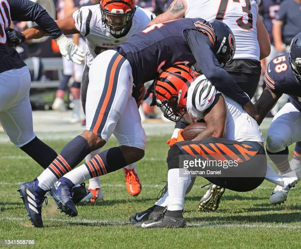 Robert Quinn of the Chicago Bears takes down Joe Mixon of the Cincinnati Bengals at Soldier Field on September 19, 2021 in Chicago, Illinois. The...