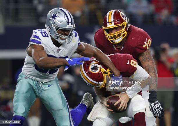 Robert Quinn of the Dallas Cowboys grabs Case Keenum of the Washington Redskins in the third quarter at ATT Stadium on December 29 2019 in Arlington...
