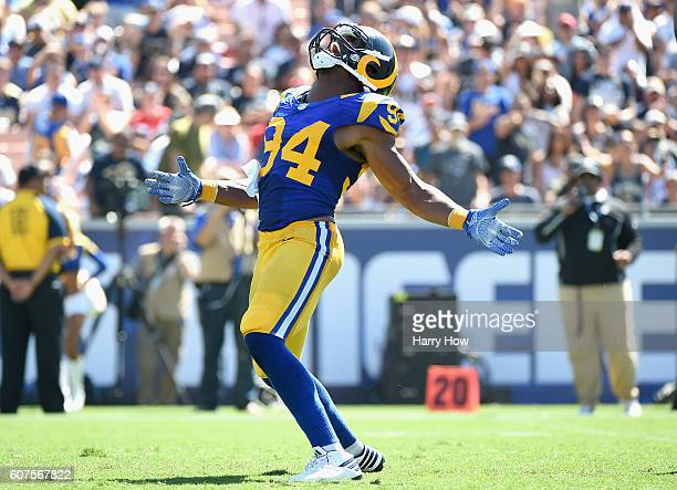 Robert Quinn of the Los Angeles Rams celebrates a sack on a play that was called back due to a penaltyduring the second quarter of the home opening...