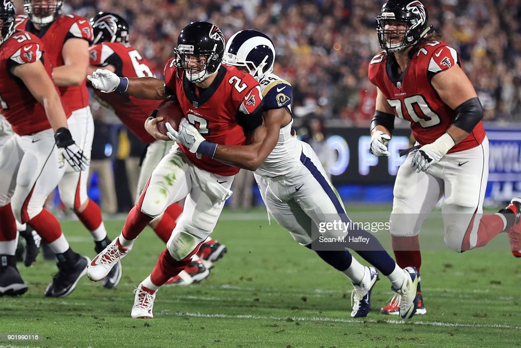 Robert Quinn #94 of the Los Angeles Rams sacks Matt Ryan #2 of the Atlanta Falcons during the NFC Wild Card Playoff Game at the Los Angeles Coliseum on January 6, 2018 in Los Angeles, California.