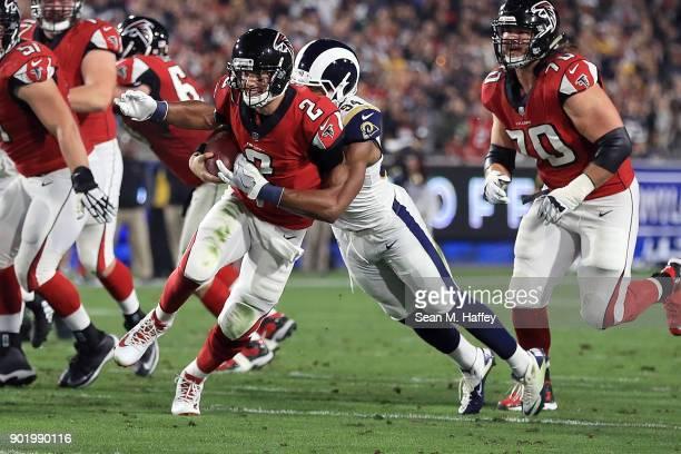 Robert Quinn of the Los Angeles Rams sacks Matt Ryan of the Atlanta Falcons during the NFC Wild Card Playoff Game at the Los Angeles Coliseum on...