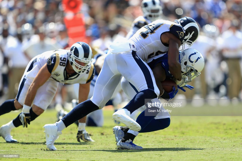 Robert Quinn #94 of the Los Angeles Rams sacks Robert Turbin #33 of the Indianapolis Colts during the first half of a game at Los Angeles Memorial Coliseum on September 10, 2017 in Los Angeles, California.