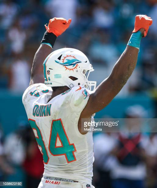 Robert Quinn of the Miami Dolphins reacts after the Miami Dolphins scored a touchdown during the fourth quarter against the Oakland Raiders at Hard...