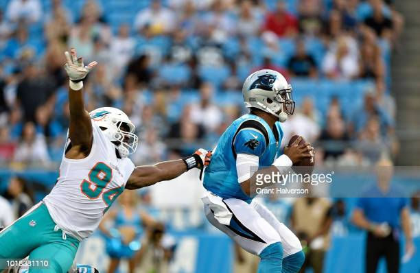 Robert Quinn of the Miami Dolphins rushes Cam Newton of the Carolina Panthers in the first quarter during the game at Bank of America Stadium on...