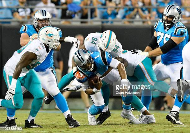 Robert Quinn of the Miami Dolphins sacks Cam Newton of the Carolina Panthers in the second quarter during the game at Bank of America Stadium on...