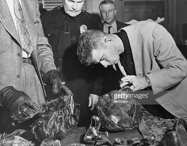 "Robert ""Red"" Manley identifies Elizabeth Short's purse in the Black Dahlia murder case. The mutilated body of Elizabeth Short, whose nickname was the..."